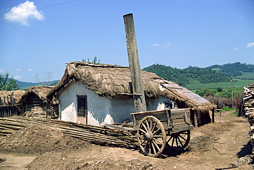 Typical rural house with straw roof in China, Asia