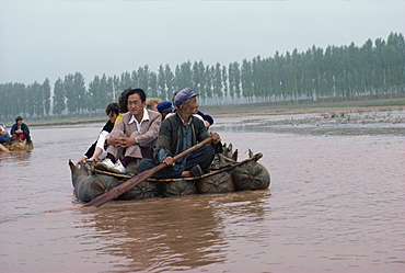 Pigskin rafts floating down the Yellow River, Ningxia Province, China, Asia