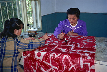Applying wax during the making of batik cloth, Duyun, Guizhou, China, Asia