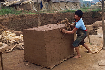 Cutting clay for tiles after it has been mixed, south east area, Guizhou, China, Asia