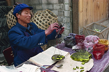 Man selling chemical dyes for domestic textile industry, Kaili, Guizhou, China, Asia