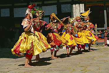 Festival dancers, Bumthang, Bhutan, Asia