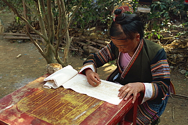 Miao girl doing wax resist, southern Guizhou, Guizhou, China, Asia