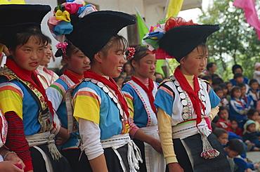 Cock Miao girls singing at performance, Guizhou, China, Asia