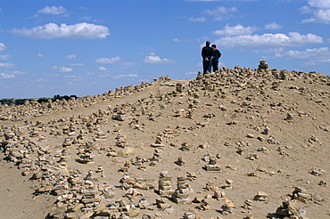 Piles of stone for good luck, Kunya Urgench, Turkmenistan, Central Asia, Asia