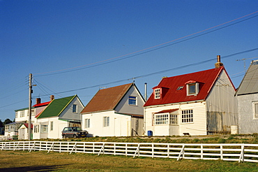 Houses of wood and corrugated iron line a typical street in Stanley, capital of the Falkland Islands, South America