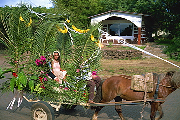 Bride and groom in wedding procession, Hanga Roa, Easter Island, Chile, South America