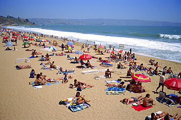Tourists and locals at popular hot-spot on Renaca Beach, Vina del Mar, Chile, South America