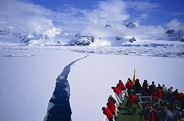 Tourist ship breaking through pack-ice, Antarctic Peninsula, Polar Regions