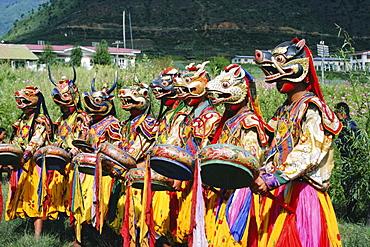 Masked Bhutanese dancers, Bhutan