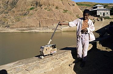 Child and toy, Axum, Ethiopia, Africa