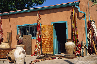Assorted ethnic items on display outside shop, Guadalupe Street, Sante Fe, New Mexico, United States of America, North America