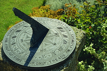 Sundial on plate of slate inscribed Noiseless falls the foot of time that only treads on flowers 1905, Little Hall, Lavenham, Suffolk, England, United Kingdom, Europe