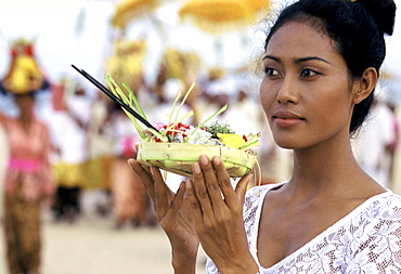Girl with offerings at a reliqious ceremony in Bali, Indonesia, Southeast Asia, Asia