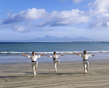 People performing White Crane Silat, an ancient martial art now used for exercise, on Jimbaran Beach, Bali, Indonesia, Southeast Asia, Asia