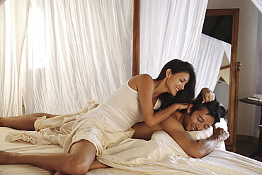 Couple on a tented bed, Maldives, Asia