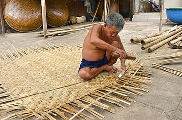 Weaving a basket tug boat, Phan Thiet, Vietnam, Indochina, Southeast Asia, Asia