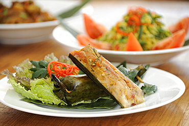 Balinese food, including Ikan pepes, fish grilled in a banana leaf packet, Bali, Indonesia, Southeast Asia, Asia