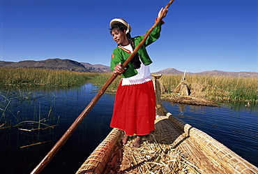 Portrait of a Uros Indian woman on a traditional reed boat, Islas Flotantes, floating islands, Lake Titicaca, Peru, South America