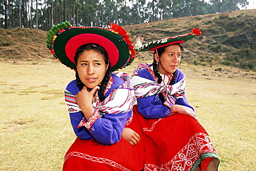 Portrait of two young local women in traditional dress, near Cuzco, Peru, South America