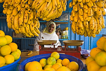 Woman selling fruit in a market stall in Gonder, Gonder, Ethiopia, Africa