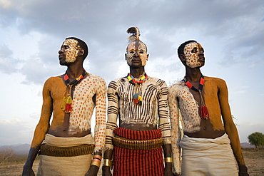 Karo tribesmen with face and body painting imitating the spotted plumage of the guinea fowl, Omo river, Lower Omo Valley, Ethiopia, Africa