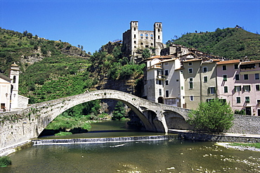 The 15th century Doria's castle and medieval bridge across the River Nervia, Dolceacqua, Italian Riviera, Liguria, Italy, Europe