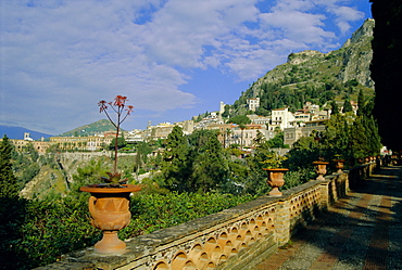 View over city from the public gardens, Taormina, Sicily, Italy, Europe
