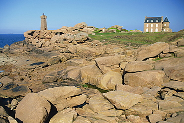 Rocks on the coast and the lighthouse at Ploumanach, on the Cote de Granit Rose, on the Cotes d'Amor, Brittany, France, Europe