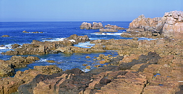 Rocks on the coast at Pointe du Chateau, Le Gouffre, on the Cote de Granit Rose in the Cotes d'Amor, Brittany, France, Europe