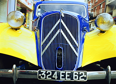 Close-up of front radiator, number plate and lamps on a Citroen 4CV in France, Europe
