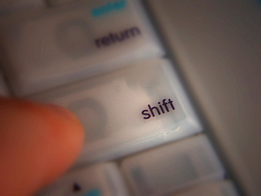 Pressing the Shift key on a computer keyboard