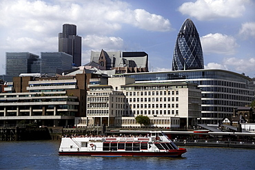 View across the River Thames to the City of London, with the Gherkin (Swiss Re Building) and Natwest Tower on skyline, London, England, United Kingdom, Europe
