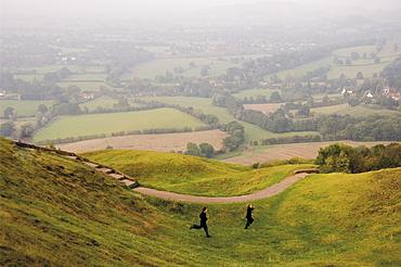 Tow children running down path, British Camp, Hereford Beacon, Malvern Hills, Herefordshire, Midlands, England, United Kingdom, Europe