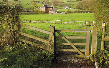 Stile and footpath with lock keepers house beyond, on the Worcester and Birmingham canal, Tardebigge, Worcestershire, England, United Kingdom, Europe