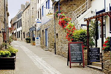 Narrow street with half timbered houses and seafood restaurants, Treguier, Cote de Granit Rose, Cotes d'Armor, Brittany, France, Europe