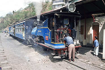 Toy train from Darjeeling to plains refuelling at Goom station, West Bengal state, India, Asia