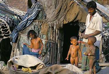 Family at front door of their rag shanty home, Kolkata (Calcutta), West Bengal, India, Asia