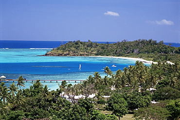 Lagoon with coral sand beach protected by outer coral reef, Mana Island in Mamanuca Group, Fiji
