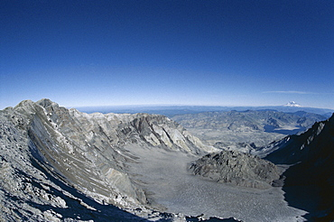 Lava dome in crater seen from rim, Mount St. Helens after 1980 eruption, with Spirit Lake and Mount Rainier in the distance, Mount St. Helens National Volcanic Monument, Washington State, United States of America (U.S.A.), North America