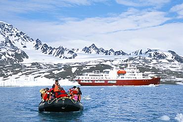 Tourists in zodiac from ice-breaker tour ship, Krossfjorden icebergs and glacier, Spitsbergen, Svalbard, Norway, Scandinavia, Europe
