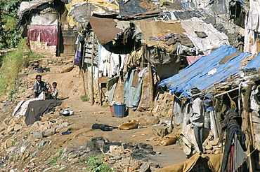 Untouchables (Harijan) in shanty hovels alongside river in town centre, Coonor, Tamil Nadu, India, Asia