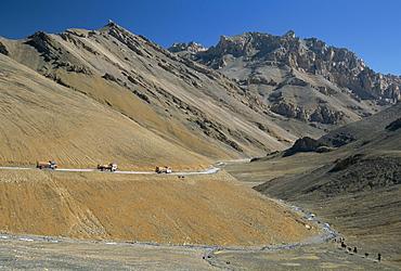 Trucks on the Lachalang Pass, 5065m, Zanskar people on horse trail, Leh-Manali hgihway, Ladakh, India, Asia