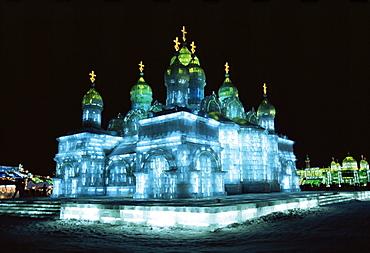 Ice sculptures in Taiyangdao Park at night, Ice Lantern Festival, Bingdeng Jie, Harbin city, Heilongjiang, China, Asia