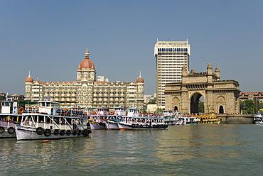 Gateway of India on the dockside beside the Taj Mahal Hotel, Mumbai, India, Asia