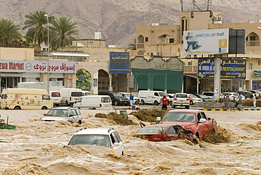 A flash flood in the wadi through the centre of town, Nizwa, Oman, Middle East
