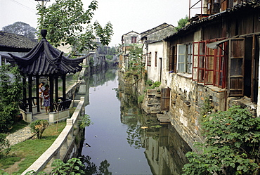 Venice of the East', one of the many canals still in use, lined with typical houses, Suzhou, eastern China, Asia