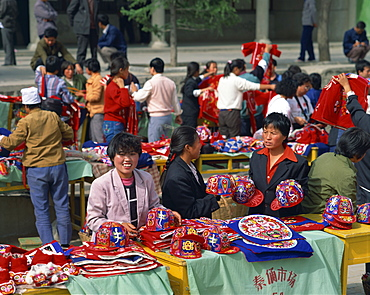Women selling colourful hats in the market at Xian, Shaanxi, China, Asia