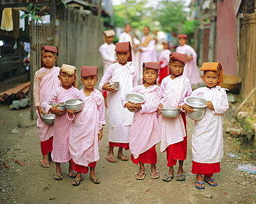 Young nuns with begging bowls, Mandalay, Myanmar, Asia