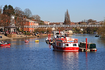 Boats and suspension bridge over the River Dee, Chester, Cheshire, England, United Kingdom, Europe